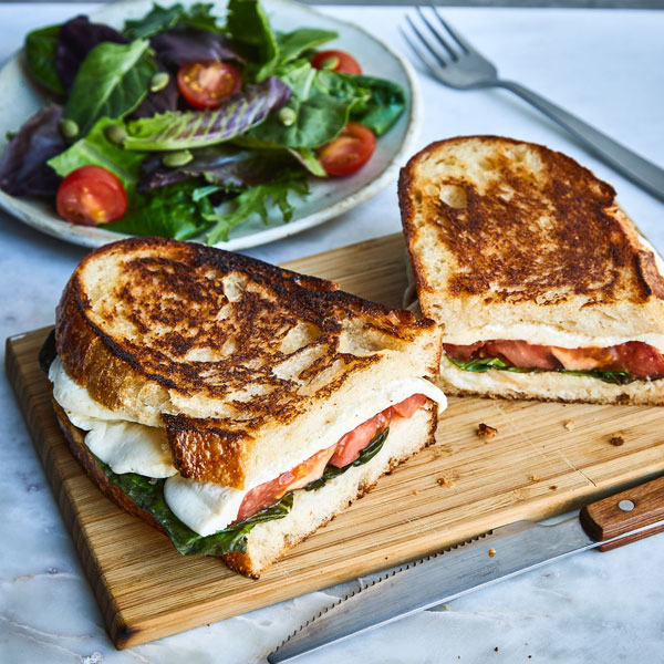The Tuscan Grilled Cheese, fresh mozzarella, tomatoes, basil & salad