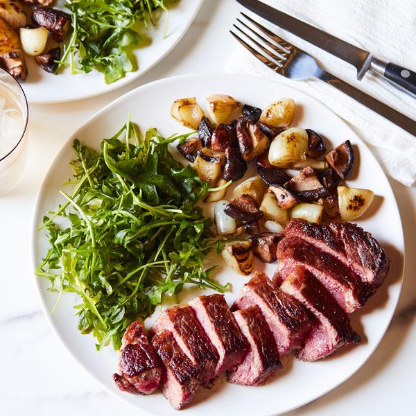 Double R Ranch NY Steak, mushrooms, onions & arugula salad